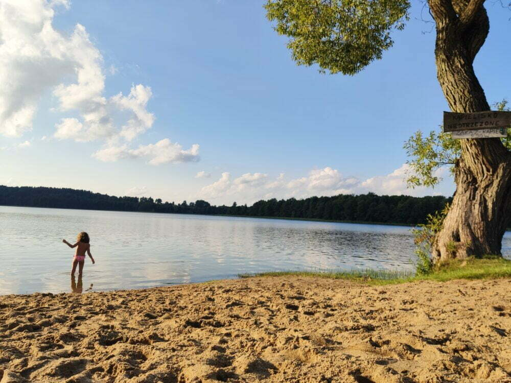 Lake and beach of Camping Tumiany